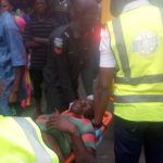 Hawker Falls Off A Bridge In Lagos After Being Hit By A Danfo Bus. Photos